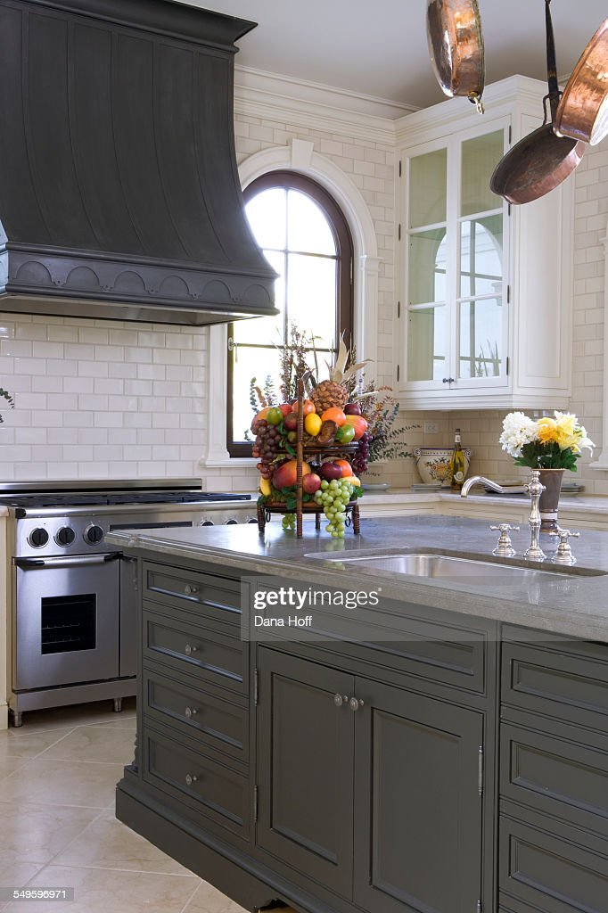 White brick and grey kitchen with painted island : Stock Photo