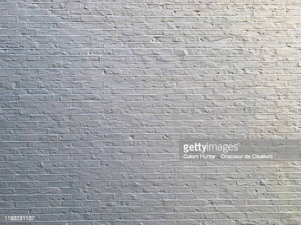 white brick wall in london - mural stock pictures, royalty-free photos & images