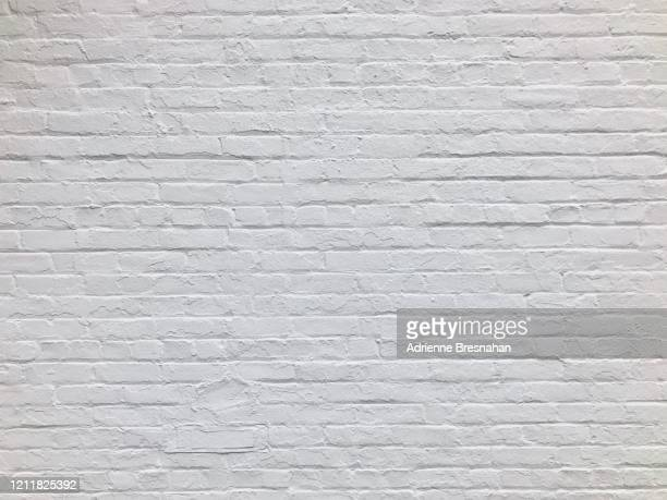 white brick wall - wand stock-fotos und bilder