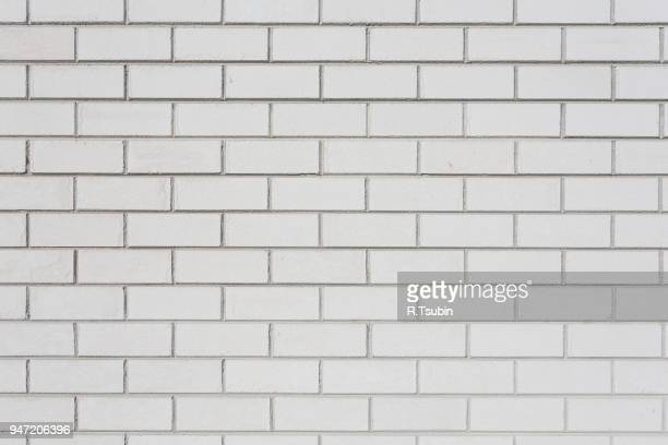 white brick wall. seamless photo background texture - tile stock photos and pictures