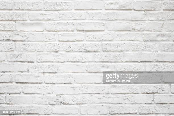 white brick wall texture background - ladrillo fotografías e imágenes de stock