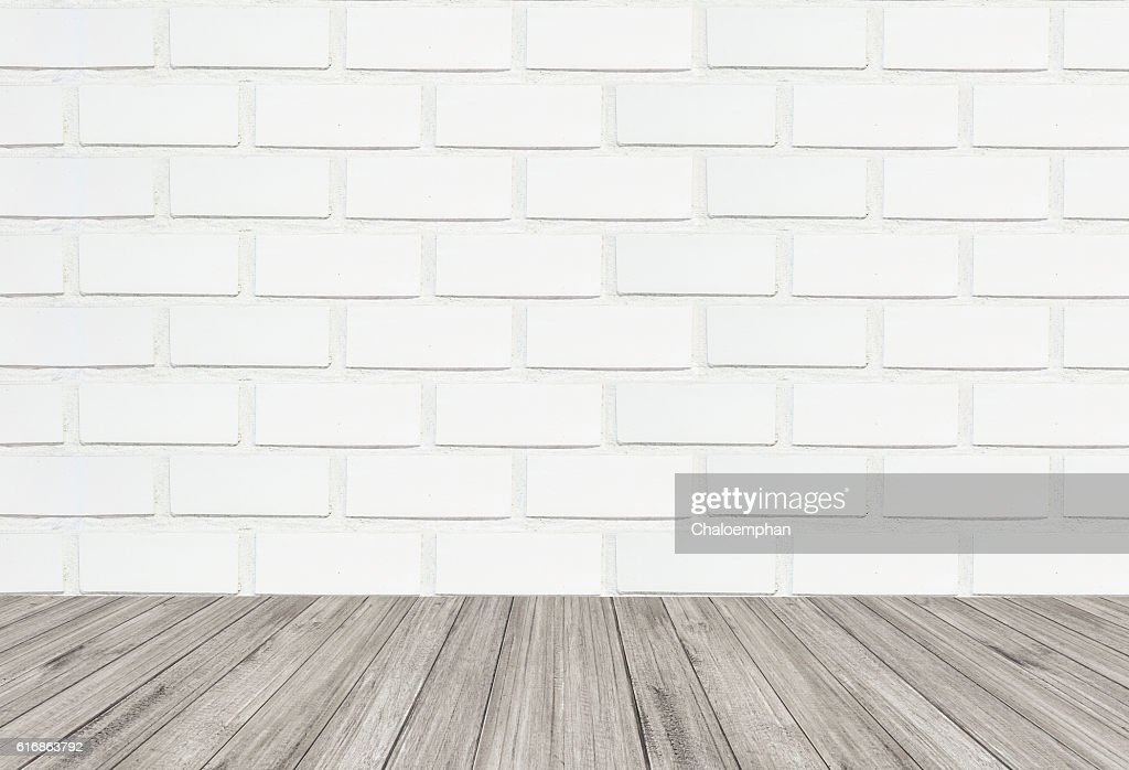 White brick wall texture background with wooden floor : Stock Photo