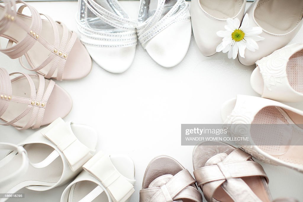White bridesmaid and wedding shoes in a circle : Stock Photo