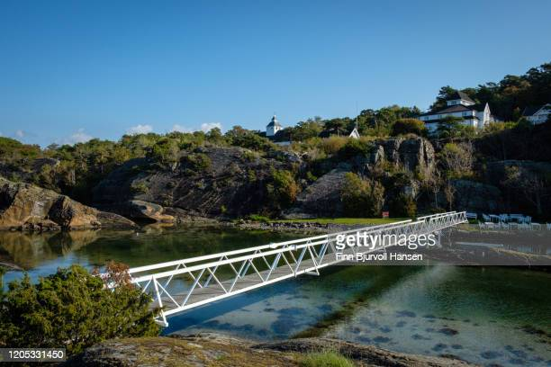 white bridge over a pond of water - finn bjurvoll stock pictures, royalty-free photos & images