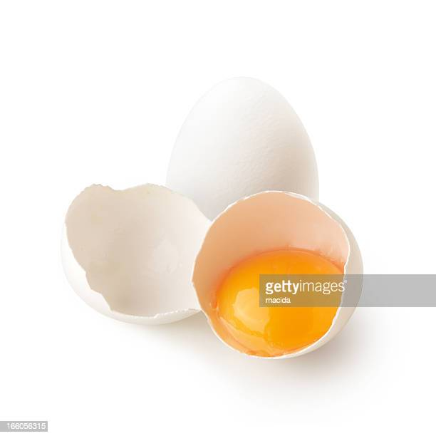 White broken egg shell containing yellow yolk
