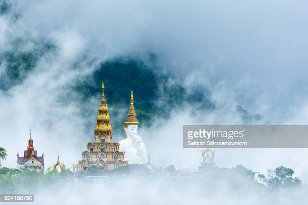 White buddha in the mist