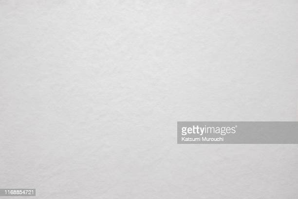 white bumpy paper texture background - paper texture stock pictures, royalty-free photos & images