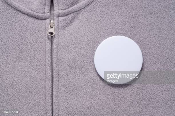 White Button Badge on Gray Cloth