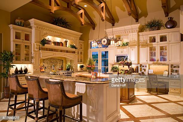 White Cabinetry in Traditional Kitchen with Wood and Marble Floor