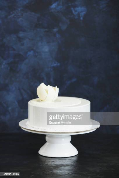 white cake decorated with chocolate flower - cakestand stock pictures, royalty-free photos & images