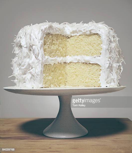 A white cake with vanilla icing sits on a cake plate November 1986 United States