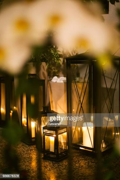 White candles in black glassed boxes