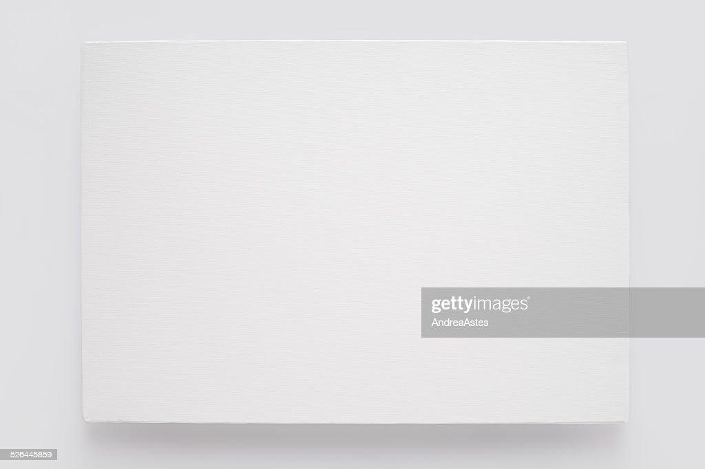 White canvas on stretcher on white wall