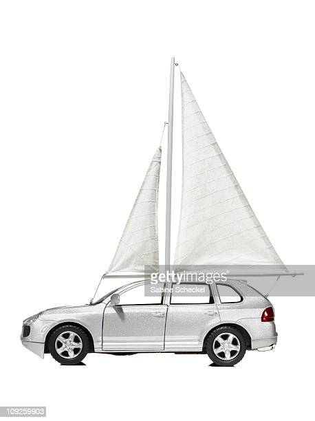 White car/ automobile with sail hoisted