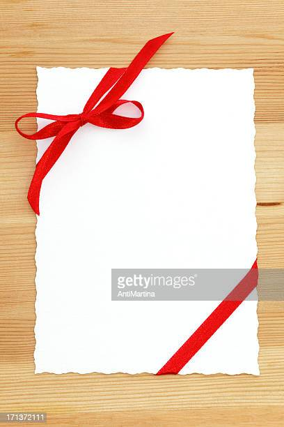 white card with space for text and red bow