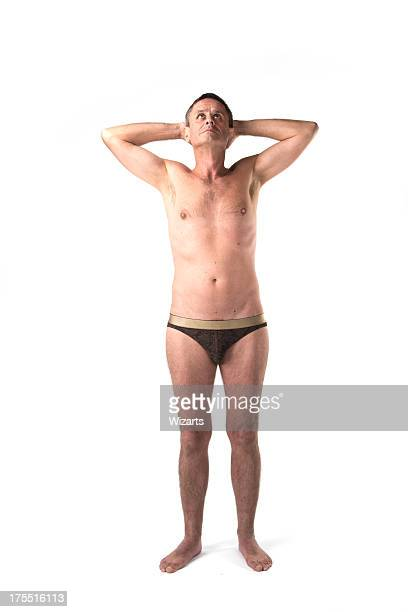 white caucasian man semi nude - naturist male stock pictures, royalty-free photos & images