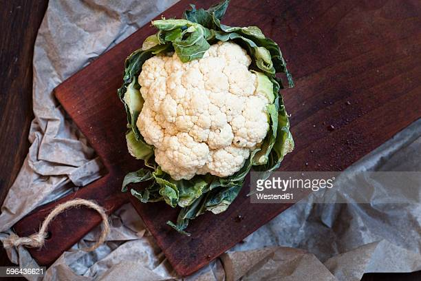 White cauliflower on chopping board