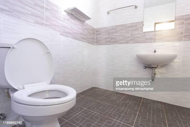 white ceramic bidet and toilet at luxury bathroom, nobody - ビデ ストックフォトと画像