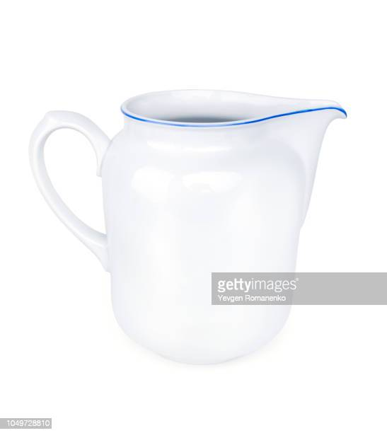 white ceramic pitcher isolated on white background - pitcher stock pictures, royalty-free photos & images