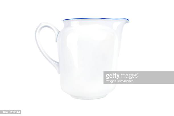 White ceramic pitcher isolated on white background