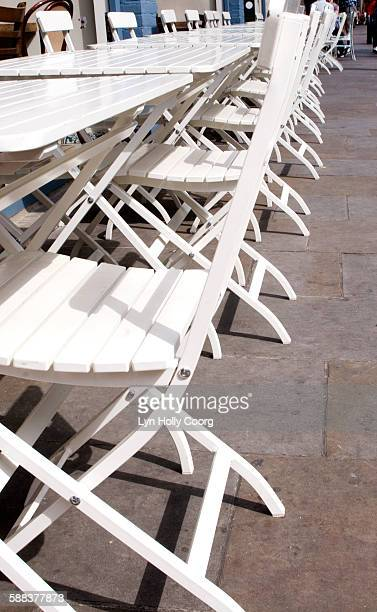 white chairs and tables outside street cafe - lyn holly coorg stock pictures, royalty-free photos & images