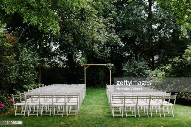 white chairs lined up for wedding ceremony - wedding ceremony stock pictures, royalty-free photos & images