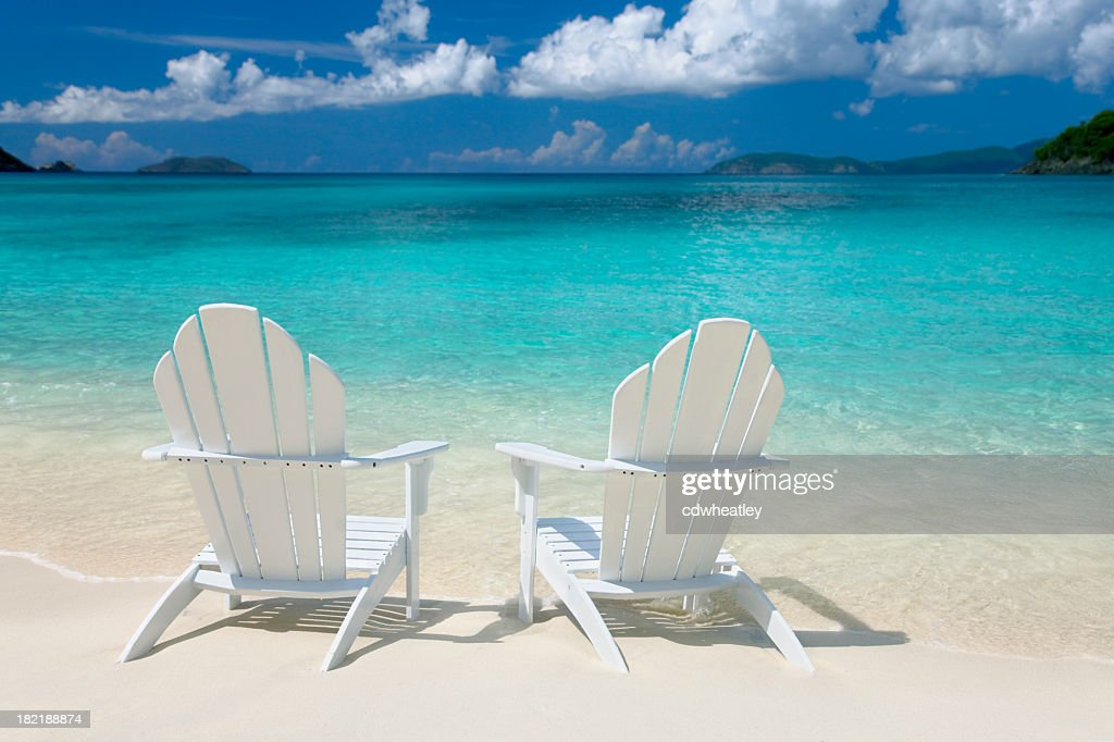 Beau White Chairs On The Caribbean Beach