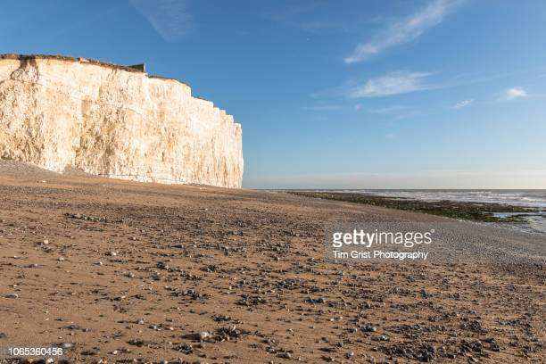 white chalk cliffs and sandy beach near beachy head, east sussex - eroded stock pictures, royalty-free photos & images