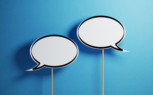 White Chat Bubbles With Wooden Sticks On Blue Background 937868004