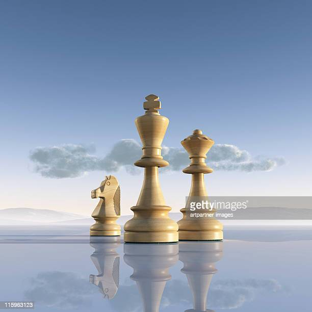 White Chess Pieces on a reflecting Surface