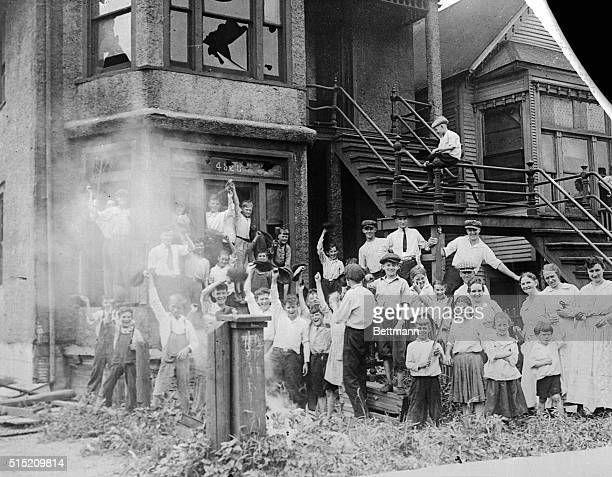White children cheer outside an AfricanAmerican residence that they have set on fire The police arrived soon afterward