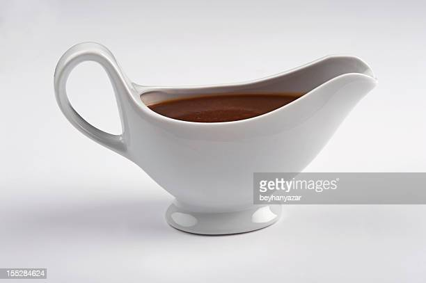 white china gravy boat isolated on white background. - gravy stock photos and pictures