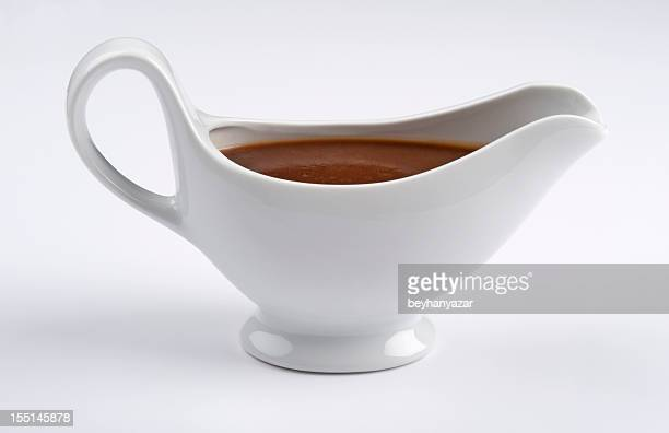 white china gravy boat on white background - gravy stock photos and pictures