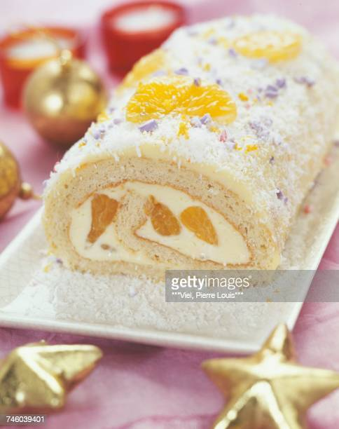 white chocolate,mandarin and coconut christmas log cake - yule log stock photos and pictures