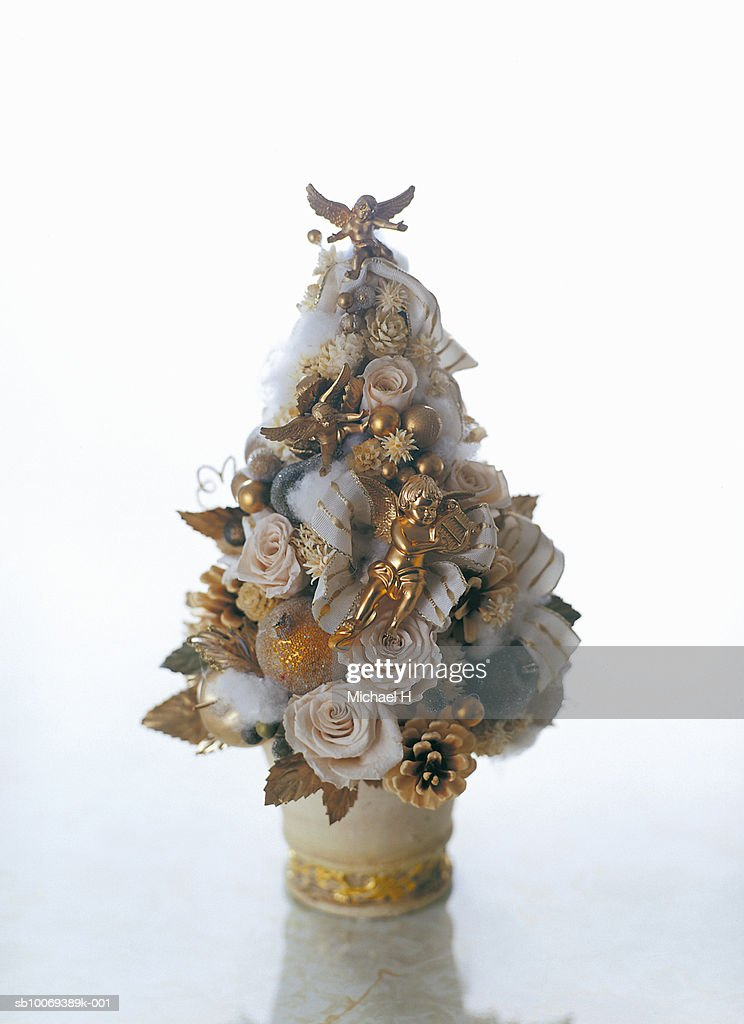 Angel Ornaments For Christmas Tree.White Christmas Tree Of Roses And Gold Angel Ornaments High