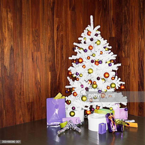 white christmas tree with decorations and gifts - microzoa stock pictures, royalty-free photos & images