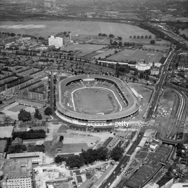 White City Stadium, London, July 1966. Originally built for the 1908 summer Olympics, it became the home of greyhound racing and hosted a number of...