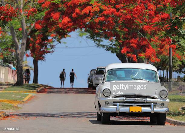white classic vintage cuban car and pedestrians - varadero beach stock pictures, royalty-free photos & images