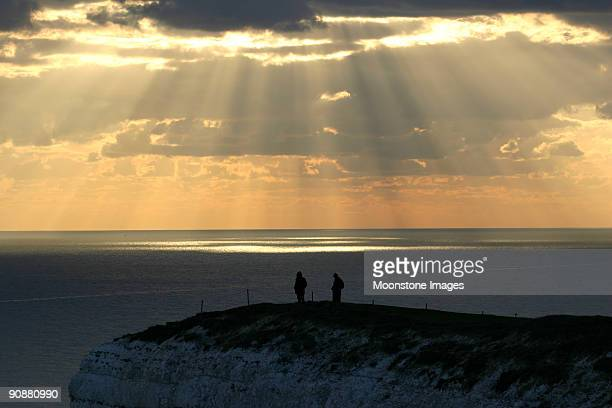 white cliffs sunset, england - eastbourne stock photos and pictures