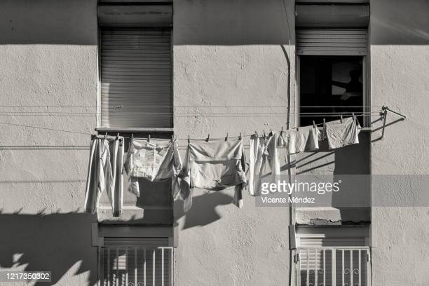 white clothes hanging - white shirt stock pictures, royalty-free photos & images