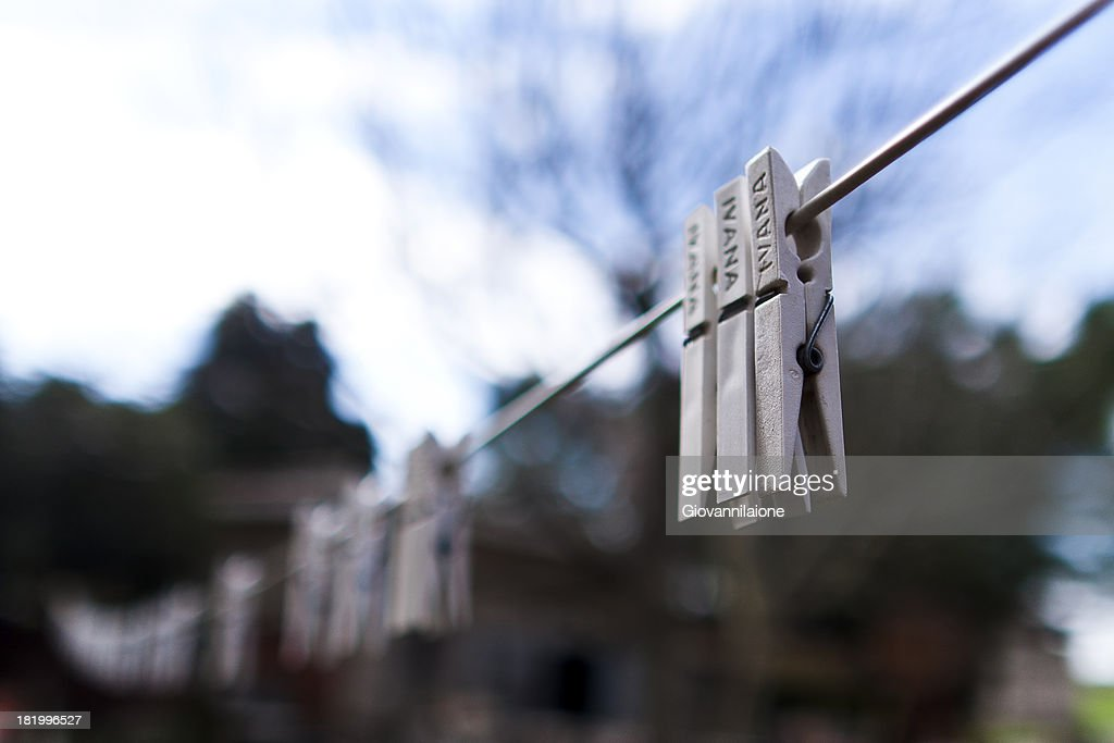 White Clothespins Hanging On A Wire Stock Photo Getty Images