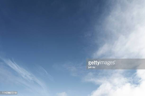 white clouds in a clear sky - sky only stock pictures, royalty-free photos & images