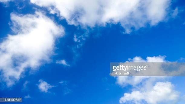 white clouds in summer blue sky - blue stock pictures, royalty-free photos & images