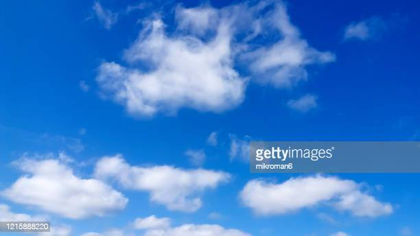 white clouds in summer blue sky - heatwave stock pictures, royalty-free photos & images