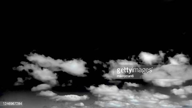 white clouds in the black sky - cloudscape stock pictures, royalty-free photos & images
