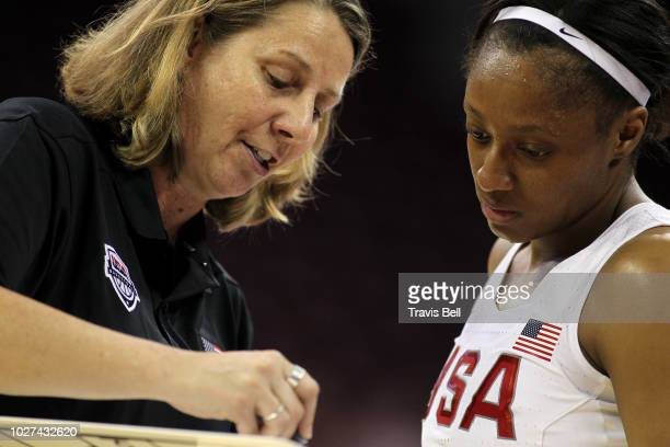 White Coach Cheryl Reeve reviews a play with Kelsey Mitchell of USA White during an exhibition game on September 5, 2018 at the University of South...