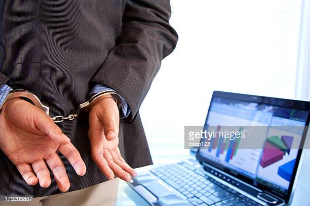 white collar crime.  businessman in handcuffs. - arrest stock pictures, royalty-free photos & images