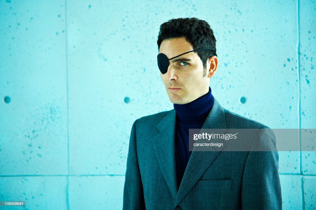 White collar crime: businessman with eye patch : Stock Photo