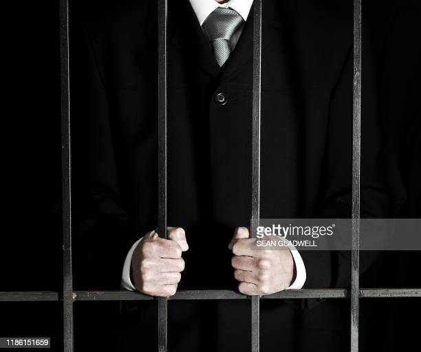 white collar crime - prison bars stock pictures, royalty-free photos & images