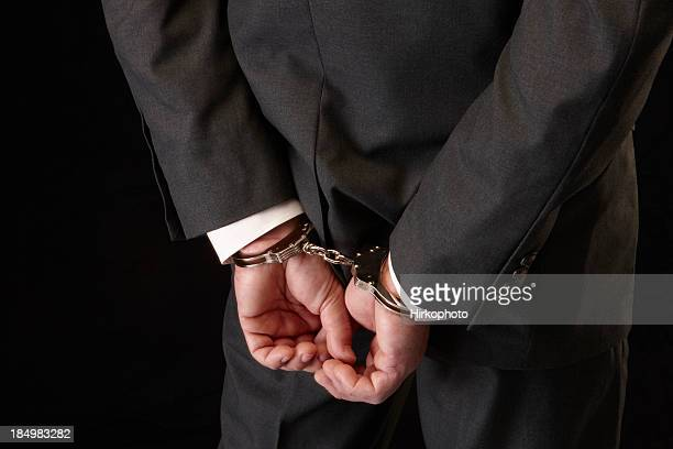 white collar crime - handcuffs stock pictures, royalty-free photos & images